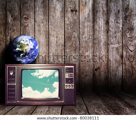 Old vintage TV in the Vintage wooden room  : Earth view image from http://visibleearth.nasa.gov/
