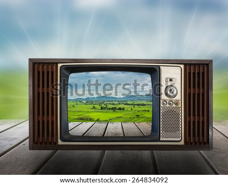 Old vintage TV in the Vintage wooden with nature view