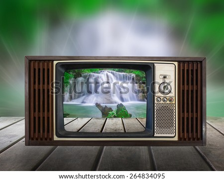 Old vintage TV in the Vintage wooden with water fall view