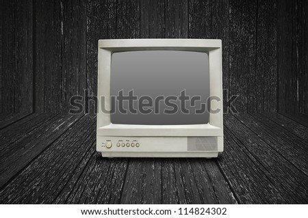 Old vintage TV isolated on wood background