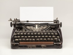 Old Vintage Typewriter and a blank sheet of paper inserted