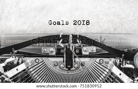 old vintage typewriter happy new year written goals 2018