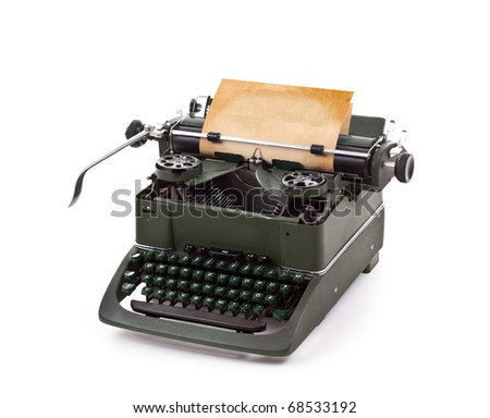 Old vintage typewriter with a blank sheet of paper inserted