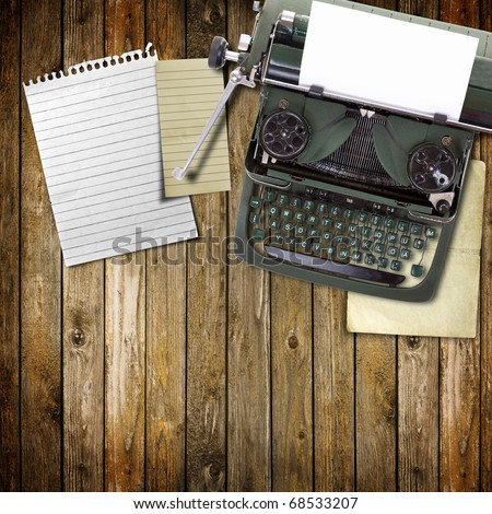 Old vintage typewriter with a blank sheet of paper inserted in wood background