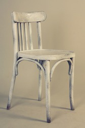 Old vintage white wooden chair isolated on white background.