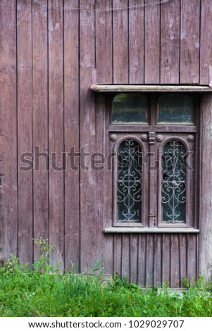 old vintage window on a wooden...