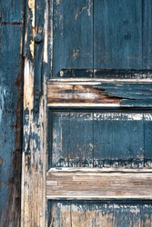 old vintage wood door peeling blue paint bare wood weathered textured background