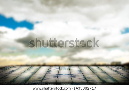 Old vintage wooden board in perspective, against the background of a blurred sky. The template can be used to display your products and advertisements. #1433882717