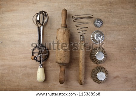 Old Vintage wooden rolling Pin with hand-cranked mixer and egg beater