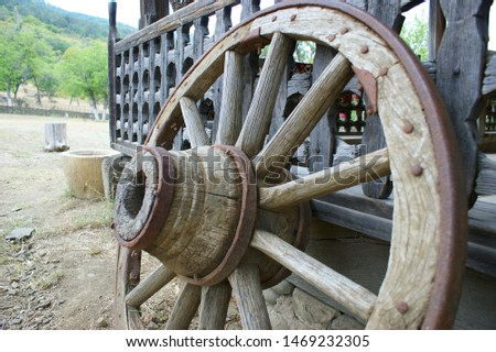 Rural antique Cart Wheels made of wood Images and Stock