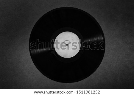 Old vinyl record on a black background