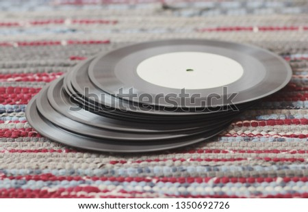 Old vinyl records, selective focus and toned image. Retro styled image of a collection of old vinyl records. #1350692726