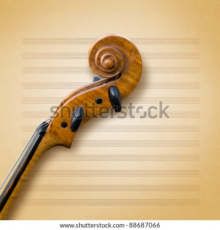 old violin on a sheet of paper