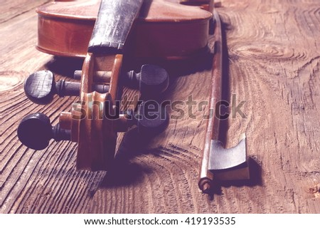 old violin on a wooden background #419193535