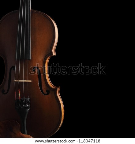 old violin on dark background - stock photo