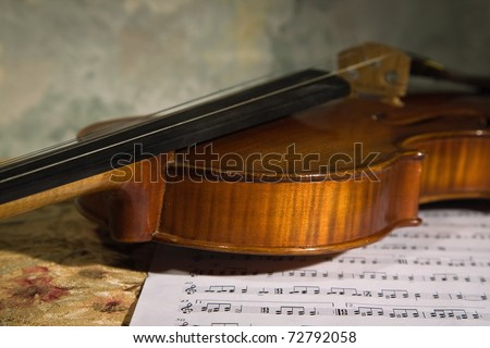 old violin over score