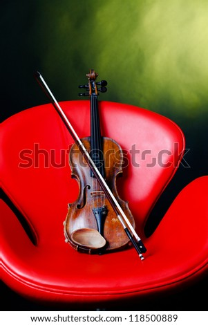 Old violin with modern armchair.