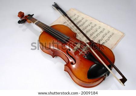Old violin with vintage music sheet