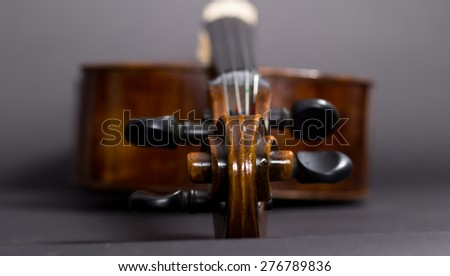 Old Violoncello on a black background. Musical instrument. Stringed musical instrument. cello