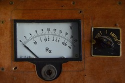 Old volt and ampere gauges control panel on the plate handmade