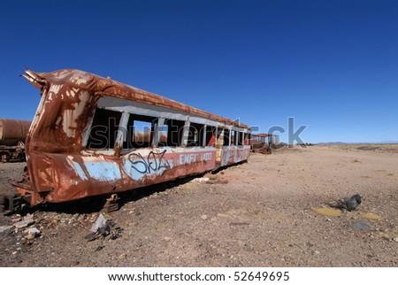 stock-photo-old-wagon-in-the-desert-of-bolivia-52649695.jpg