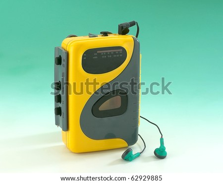 Photo of  old Walkman on green background
