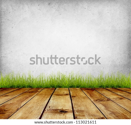 Old wall and green grass on wood floor background