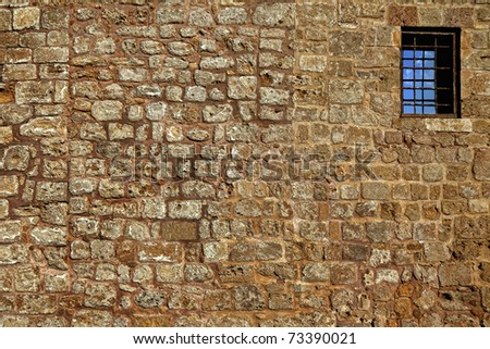 Old wall from the Jerusalem stone and window with lattice