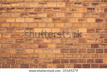 Old wall made from yellow bricks pattern - stock photo