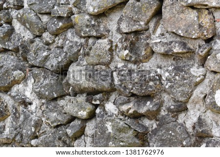Old wall made of rocks #1381762976