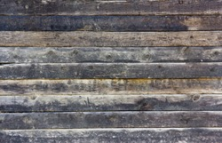 Old wall made out of wood planks is run-down and can be used for vintage backgrounds and textures.
