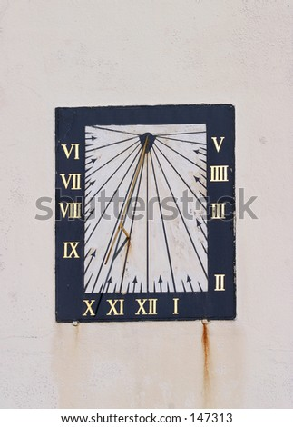 Old wall-mounted sundial