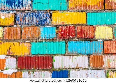Old wall multicolor. Bricks painted in a different bright color