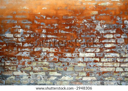 old wall of a house partly  in brick in orange colour