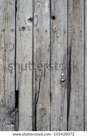 Old wall of nailed planks