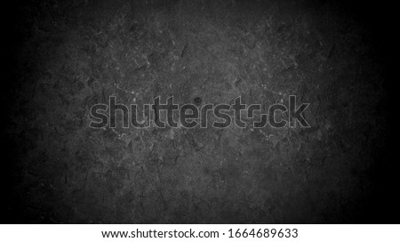 Old wall texture cement dark black gray  background abstract grey color design are light with white gradient background. stock photo