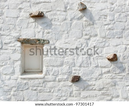 Old wall with a window with shattered. Background. Texture