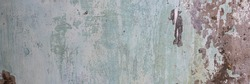 Old wall with cracked stucco. Weathered rough surface. Wide panoramic texture for background and design.