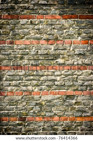 Old wall with red stripes