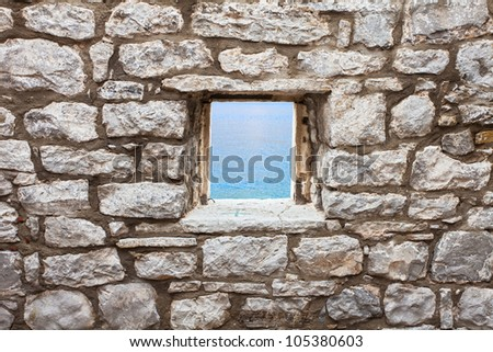 Old wall with window seaview