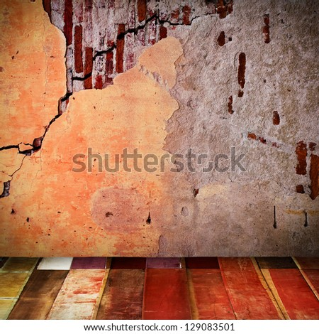 Old wall with wooden floor