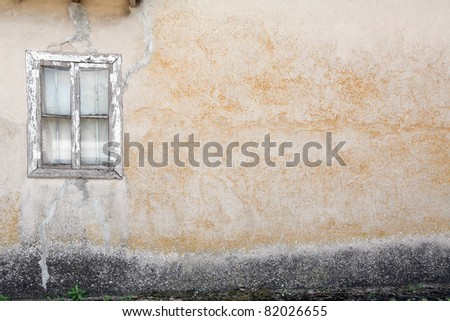 old wall with wooden window