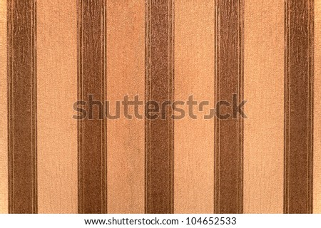 Old wallpaper with vertical brown and beige stripes
