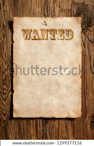old wanted advert paper nailed on aged wooden wall