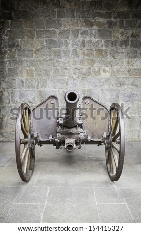 Old war cannon, detail of an ancient weapon of war and destruction, classic and historic