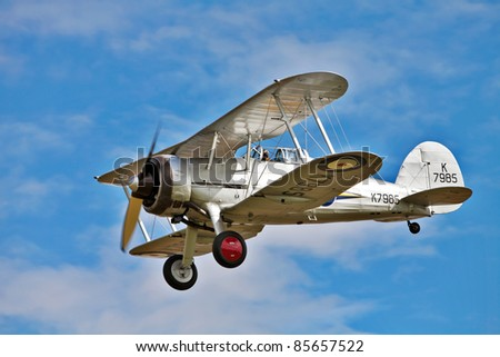 OLD WARDEN, ENGLAND - AUG. 7: A veteran RAF Gloster Gladiator fighter plane demonstrates its maneuverability flying at low level at the Shuttleworth summer air gala on August 7, 2011 in Old Warden, UK