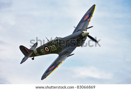 OLD WARDEN, UNITED KINGDOM-AUGUST 7: Spitfire MH434 performs a low level aerial display at the Shuttleworth Air Gala August 7, 2011 at Old Warden, UK. The MH434 is a very rare completely original Spitfire.