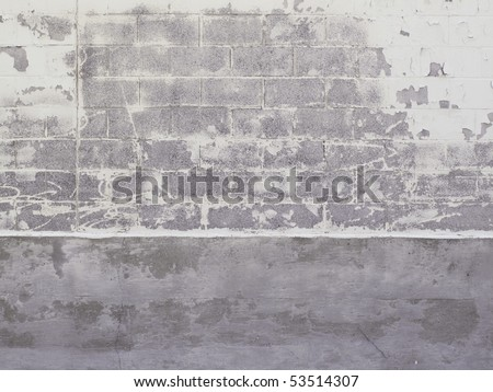 Old warehouse cinder block exterior with peeling paint