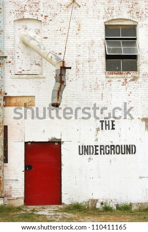 Old warehouse with red door, The underground