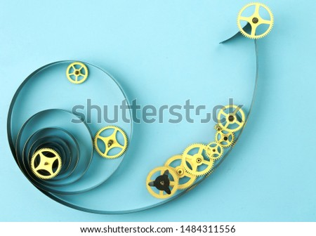 Old watch cogwheels on blue background